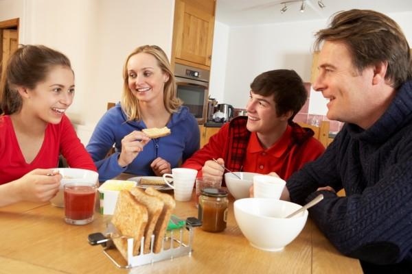 Family eating dinner in the kitchen